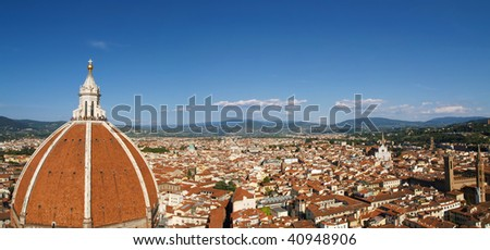 View on Florence Duomo and city from Campanile tower. Blue sky on a sunny day. Duomo Santa Maria Del Fiore. - stock photo
