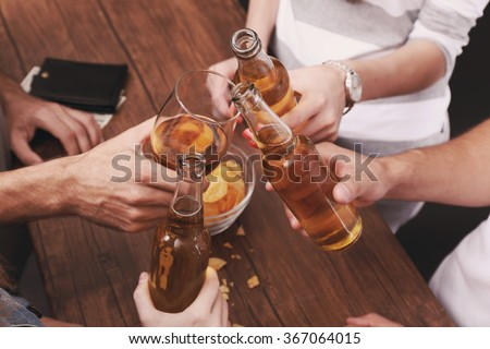 View on friends having alcoholic drinks in the bar, close-up - stock photo