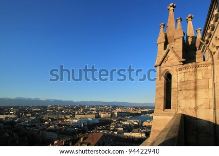 View on Geneva city and Jura mountain from  a tower of Saint-Peter cathedral, Switzerland - stock photo
