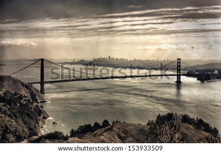 View on Golden Gate Bridge and San Francisco, vintage look with added paper texture effect - stock photo