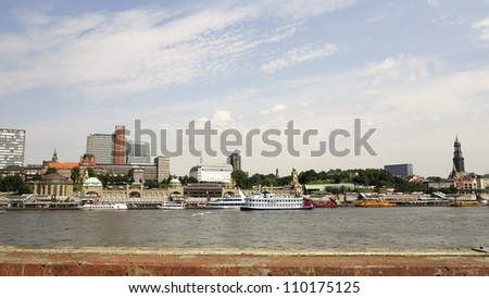 View on Hamburg city with harbor (Landungsbrucken), river Elbe and church Michel - stock photo