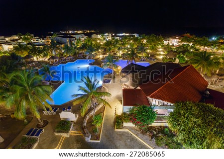 View on hotel and swimming pool at night, Cayo Largo, Cuba - stock photo