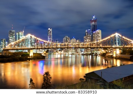 view on interesting modern bridge at night with city skyline in the background (story bridge,brisbane,queensland,australia) - stock photo