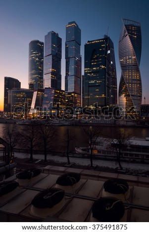View on International Moscow City Business Center in the sunset from another side of the river on the embankment