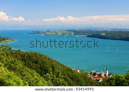 View on Lake Constance (Bodensee) with blue sky and the Alps in background - stock photo