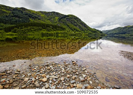 view on Loch Lubnaig with reflection, Scotland - stock photo