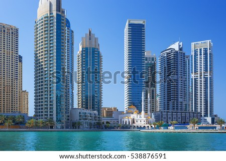 View on luxury Dubai Marina skyscrapers,promenade and mosque,Dubai,United Arab Emirates