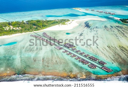 View on Maldives resort taken from airplane - stock photo