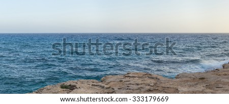 View on Mediterranean Sea from high rock bank at sunset. Cape Greko, Cyprus.