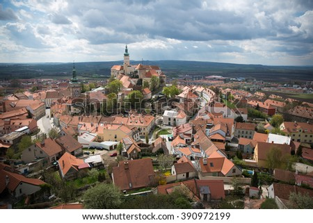 View on Mikulov town in Czech Republic with Castle and bell tower of Saint Wenceslas Church - stock photo