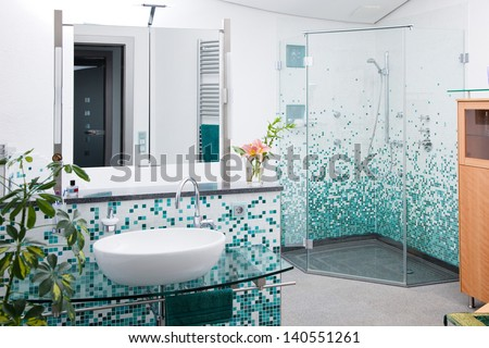 view on modern bathroom with glass shower cabin - stock photo