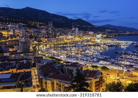 View on Monte Carlo's harbor in Monaco in the evening - stock photo