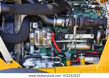 View on motor of new excavator digging - stock photo