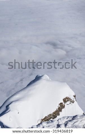 View on mountains, above clouds, Krasnaya Polyana, Sochi, Russia - stock photo