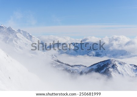 View on mountains and blue sky above clouds, Krasnaya Polyana, Sochi, Russia - stock photo