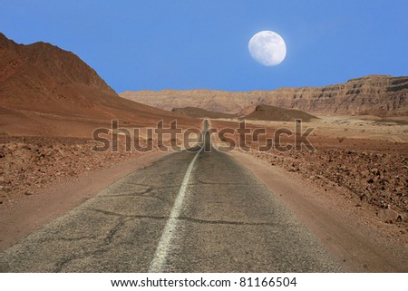 View on narrow road running through the mountains of Arava desert in Israel. - stock photo