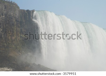 view on Niagara Falls from the bottom - stock photo