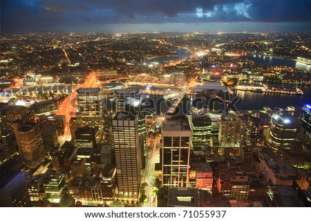 view on night highlighted Sydney CBD city from top Oztrack streets full of lights - stock photo