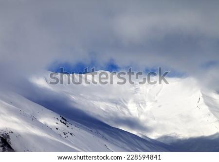 View on off-piste slope in mist. Caucasus Mountains, Georgia, ski resort Gudauri. - stock photo