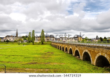 View on old houses and bridge in city of Sedan. France in rainy day