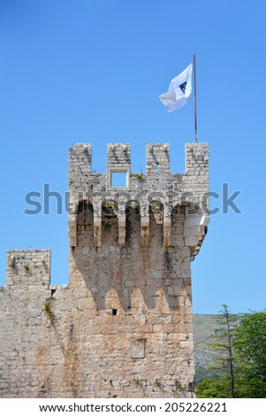 View on old Kamerlengo castle in Trogir, Croatia with flag of Trogir - architectural details