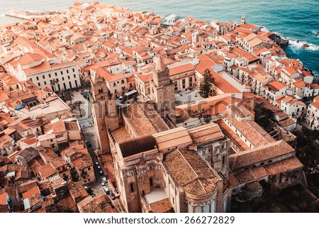 View on old red roofs and famous medieval cathedral in Cefalu city. SIcily island, Italy - stock photo