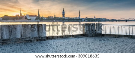 View on old Riga city from embankment of the Daugava river, Latvia. Riga is the capital and largest city of Latvia, major commercial, cultural, historical and financial center of the Baltic region   - stock photo
