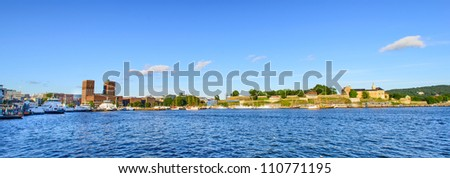 View on Oslo Fjord harbor, Oslo City Hall and Akershus Fortress, Oslo, Norway - stock photo