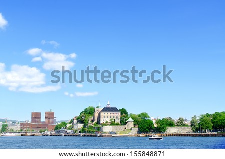 View on Oslo Fjord harbour, Akershus Fortress, Radhuset (City Hall), Oslo, Norway - stock photo