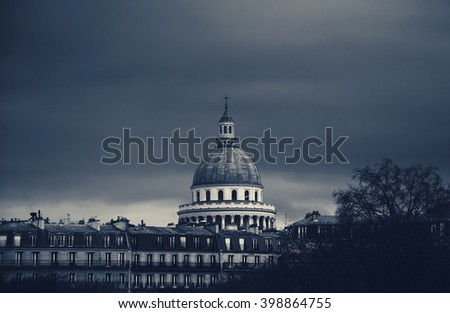 View on Pantheon building from Luxembourg gardens in cloudy day. Toned evening photo. - stock photo