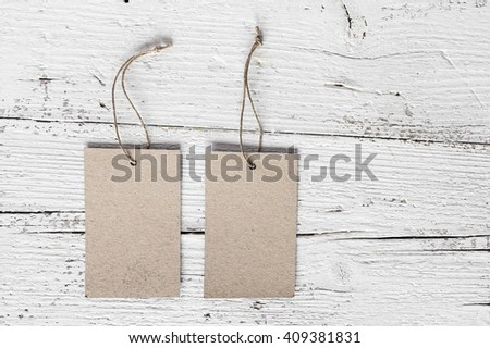 View on  paper badges on shabby wooden background.From above - stock photo