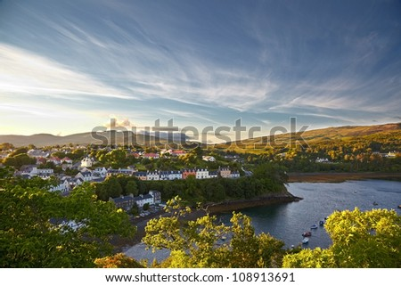 view on Portree with the Old Man of Storr on background, Isle of Skye, Scotland - stock photo