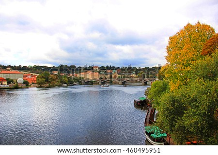View on Prague city in autumn, above River Vltava and cloudy sky - stock photo