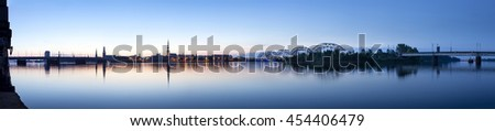 View on Riga cityline panorama in early morning over river Daugava. Panoramic montage from 11 images. - stock photo