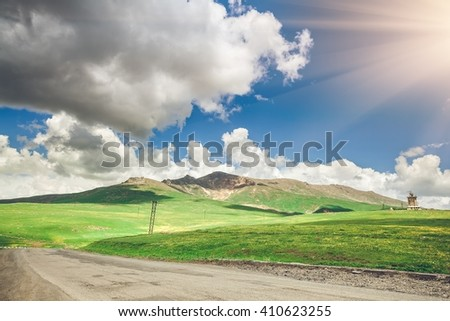View on road and blue sky with clouds. Exploring Armenia