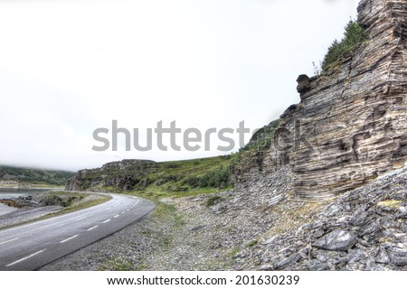 View on road and mountains in northern Norway - stock photo