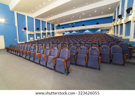 View on rows of comfortable blue chairs cinema - stock photo
