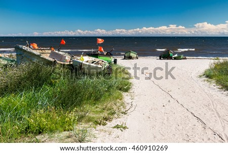 View on sandy beach near a village of collective fishing company, Baltic Sea - stock photo