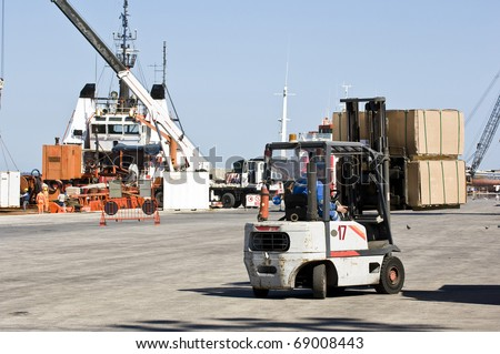 View on seaport with cranes and ship - stock photo