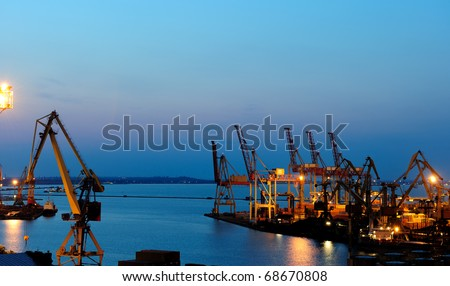 View on seaport with cranes at the night. - stock photo