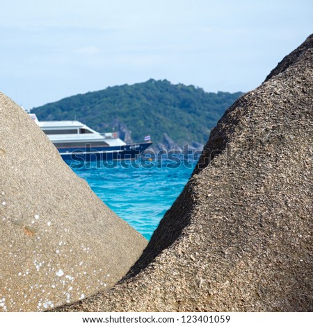 View on ship thrpogh boulders on the beach of Similan Islands, Koh Miang, National Park - stock photo