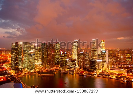 View on Singapore from Marina Bay at dusk - stock photo