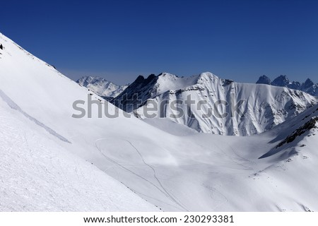 View on snowy off piste slope with trace from avalanche. Caucasus Mountains, Georgia. Ski resort Gudauri. - stock photo