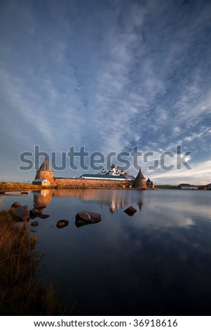 View on Solovetsky Monastery and Holy Lake with pier on sunrise