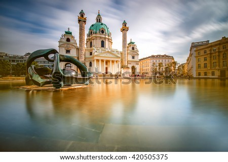 View on st. Charles's church on Karlsplatz in Vienna. Long exposure technic with blurred clouds and glossy water - stock photo
