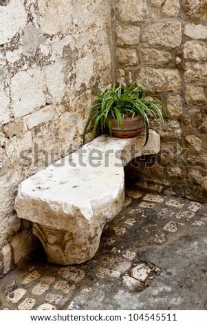 View on stony bench in Trogir, Croatia - Balkans. - stock photo