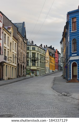 view on streets and houses at city of Alesund , Norway, vertical - stock photo