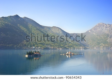 "View on Sv.Djordje (left) and Gospa od Skrpjela ( right) alo known as  Church ""Our Lady of the rocks"" in the morning. Perast, Montenegro"