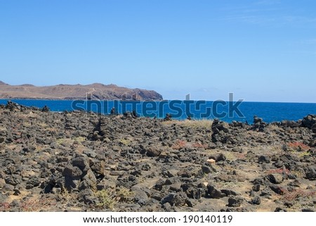 View on the barren volcanic lava coast of Lanzarote island, Spain - stock photo