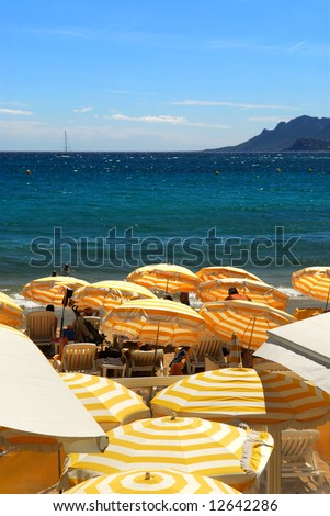 View on the beach from Croisette promenade in Cannes France - stock photo